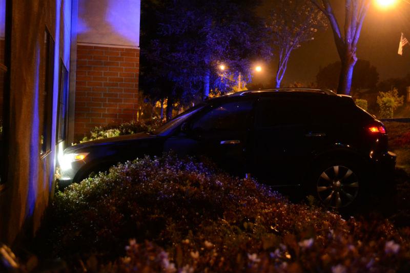 Car crashes into Li Apartments