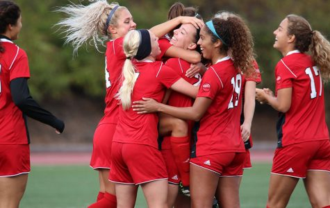 Women's soccer qualifies on last day