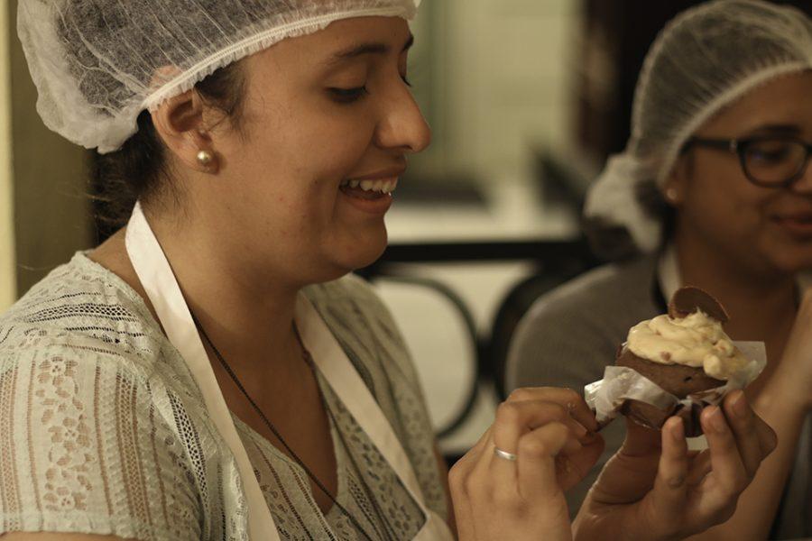 Senior+nursing+major+Linda+Venegas+eats+one+of+her+cupcakes.+