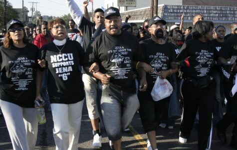 """Demonstrators in Jena, La. begin Thursday's rally in unison, chanting, """"We fired up, can't take no more!"""""""