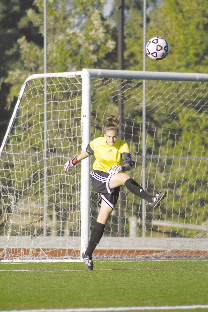 Freshman goalkeeper, Lauren Gregston, blocks an attempted goal from the opposing team.