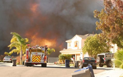 A fire truck sits in the Stevenson Ranch residential area during the Magic Moutnain fire Tuesday afternoon.