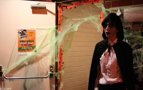 Stephen Pardini prepares for the costume contest at Tuesday's Halloween Movie Night, a fundraiser for the official Biola Film project in progress this semester.
