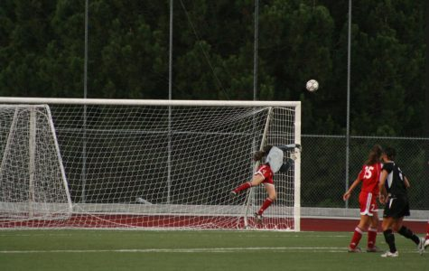 Biola goalkeeper Lauren Gregston jumps and saves the team from being scored on. Gregston made 11 saves over the course of the APU game on Saturday.