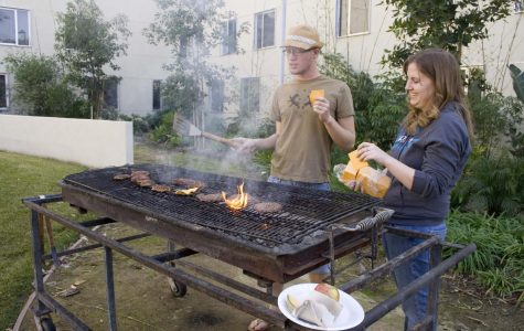 During the brother-sister barbeque friday afternoon outside Horton Hall, juniors Kevin Scholl and Stephanie Gaskins worked at the grill preparing the lunch. Hosting brother-sister floor events is just one of many duties performed by RAs.