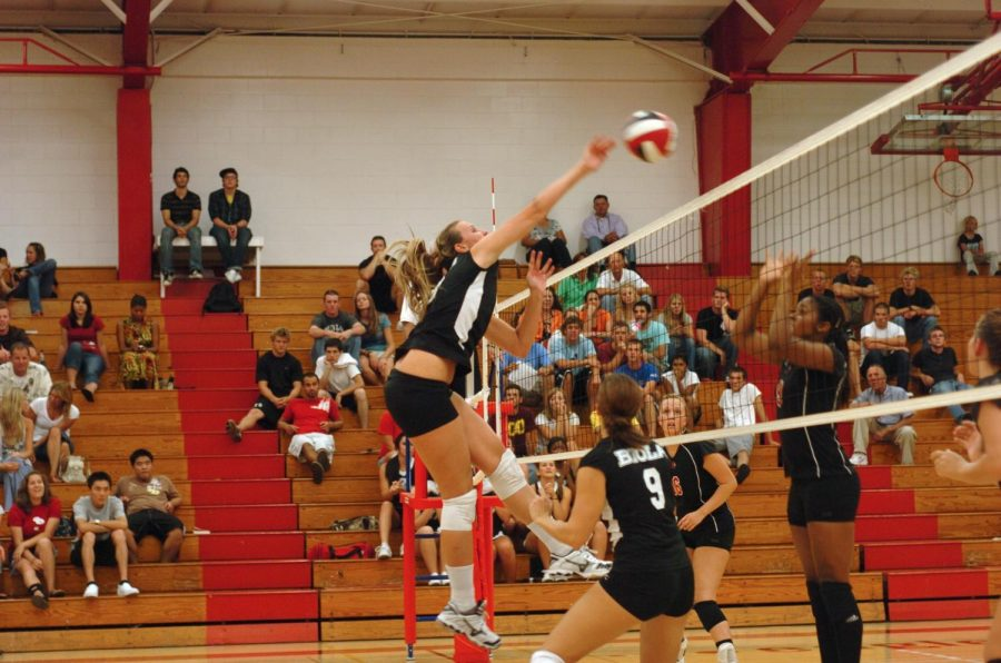 Ladies of the volleyball team work together to defeat Holy Names University with a three-set sweep on Friday night in Chase Gymnasium.