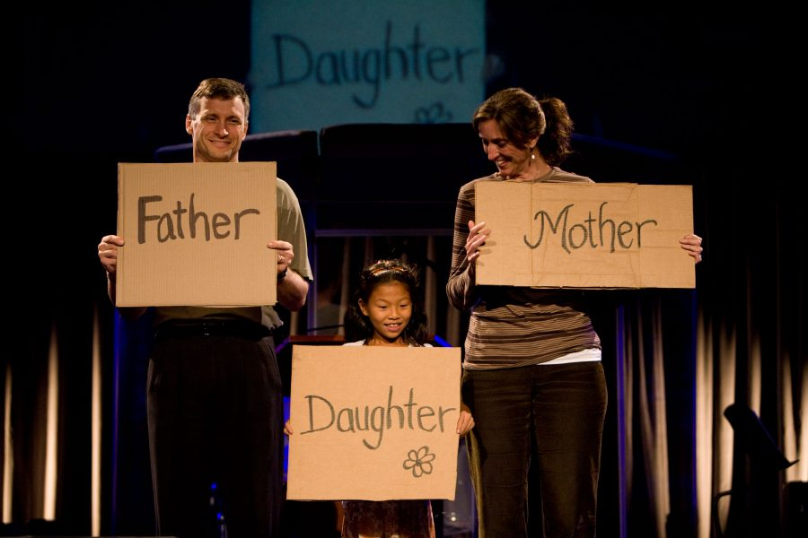 Erik+and+Donna+Thoennes%2C+both+Biola+professors%2C+hold+up+signs+with+their+daughter%2C+Caroline+Thoennes%2C+during+a+procession+of+cardboard+sign+testimonies+at+Wednesdays+final+Torrey+Conference+session.+The+couple%2C+after+being+childless+for+19+years%2C+adopted+Caroline+from+Taiwan+two+summers+ago.