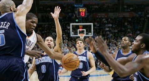 Oklahoma City Thunder forward Kevin Durant drives against Utah Jazz players before passing off during the second quarter of an NBA basketball game in Oklahoma City on March 14.