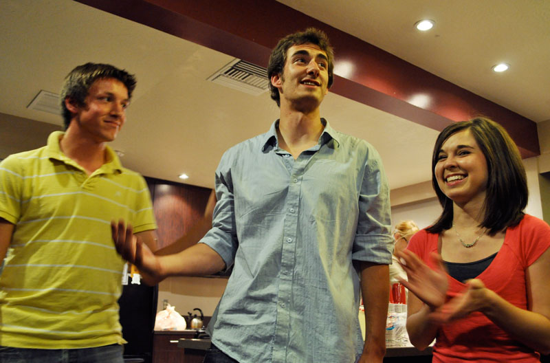 Newly-elected AS president Lizzy Neely (right) and vice president John Drebinger (left) celebrate with Andrew Harmon, their campaign manager, at a post-election party in Stewart Lobby Tuesday evening. | AMY RITTER / The Chimes