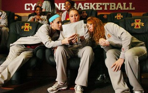 Iowa State's Shellie Mosman, Amanda Zimmerman and Chelsea Poppens, from left, look over a bracket after the broadcast of the NCAA women's basketball tournament selection show on March 15 in Ames, Iowa. | AP Photo/Ames Tribune, Ronnie Miller