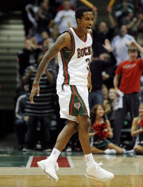 fbed2d846a9 Milwaukee Bucks rookie point guard Brandon Jennings reacts after a basket  against the Detroit Pistons during