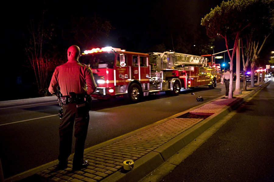 A+La+Mirada+officer+stands+by+on+the+scene+of+a+car+crash+on+the+corner+of+La+Mirada+Blvd+and+Oakwood+Lane+Tuesday+night.+City+firefighters%2C+police%2C+and+campus+safety+were+involved+in+the+scene.+No+Biola+students+were+confirmed+to+be+involved.+Photo+by+Kelsey+Heng