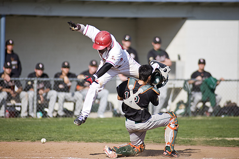 Sophomore Christopher Neal leaps to home plate to score against La Verne. Biola won 10-2 on Saturday's game, now with a standing of 2-0 for the season. |Kelsey Heng/THE CHIMES