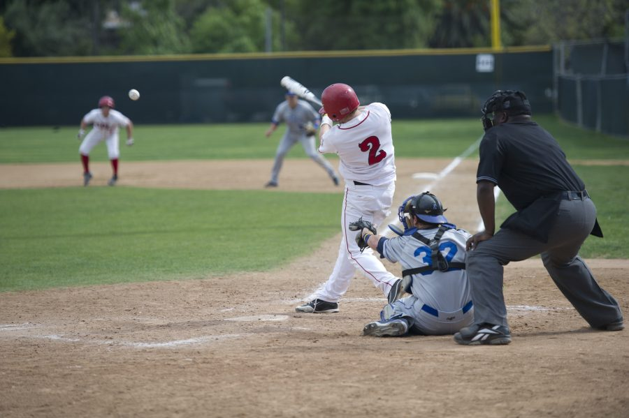Junior Boone Farrington makes a hit at Biola's home game against Cal State San Marcos on Monday afternoon. | Lauren Kermelis/THE CHIMES