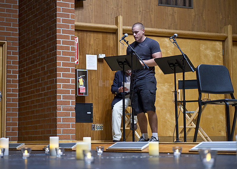 Student David Downey reads a selection from the Holocaust stories at the Holocaust remembrance chapel on Monday. | Lauren Kermelis/THE CHIMES
