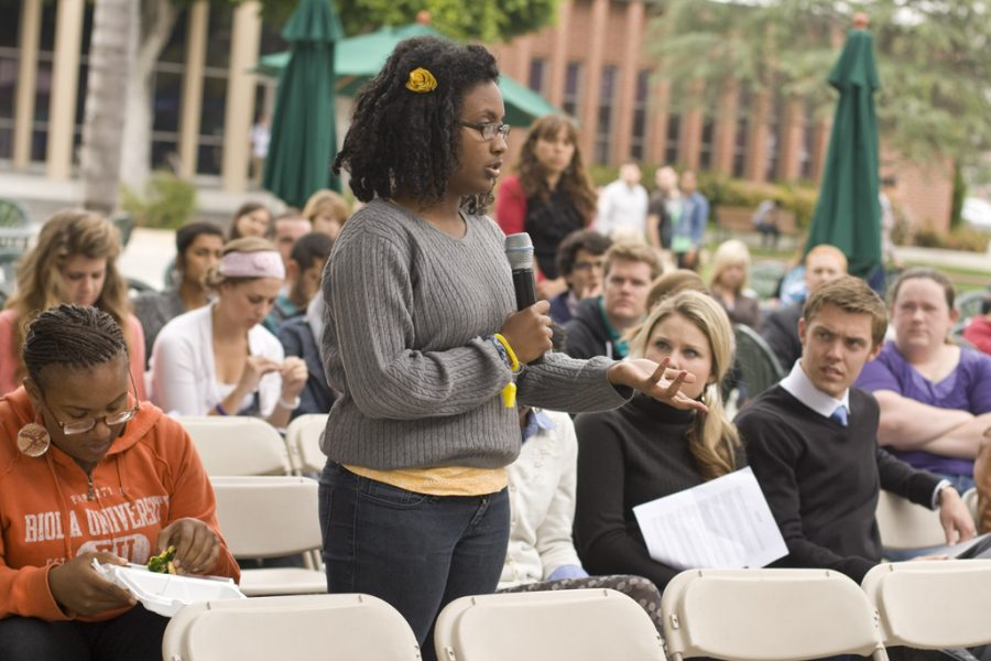 Freshman Miehrit Kassa poses a question at the PAC Town Hall meeting at Biola on Wednesday, April 20, where students were able to ask questions of Biola faculty concerning diversity, housing, and any other concerns. | Katie Juranek/THE CHIMES
