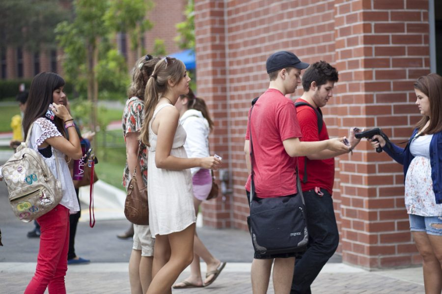 SCANNINGIN: Students arrive at chapel on Wednesday morning, Sept. 28. Chapel Board announced on Monday that students who fail to physically attend at least 15 chapels per semester will be fined $375, with the opportunity to attend a one day retreat to reduce the fine. | Job Ang/THE CHIMES