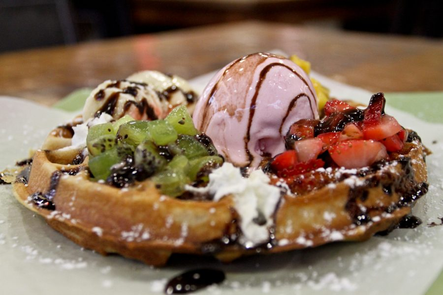 The strawberry and banana waffle comes with fresh fruit and strawberry gelato on top. | Tyler Otte/THE CHIMES