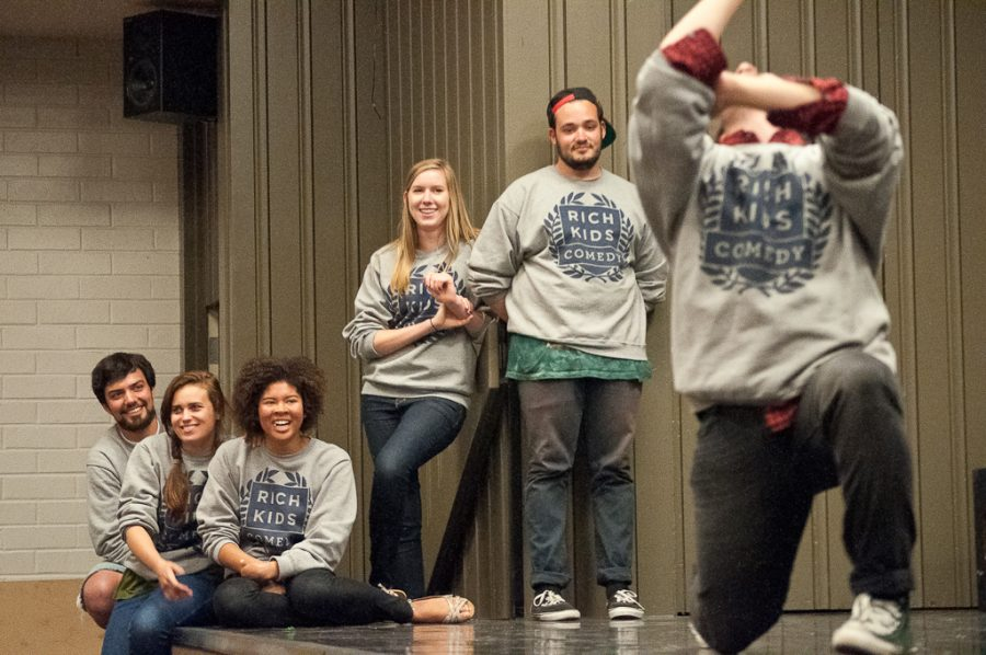 Team members looks on as junior Michael Mauriello participates in a scene in last Sunday's show. Rich Kids Comedy Club performed their final show of the year on May 13 in Mayers Auditorium. The free show attracted a full audience. | David Wahlman/THE CHIMES