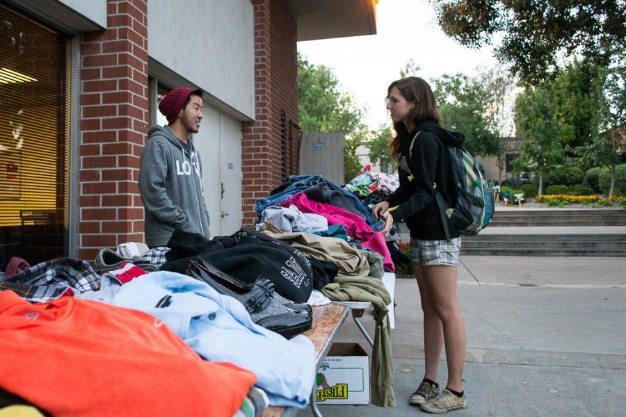 Freshman Hannah Brown browses through clothing at the