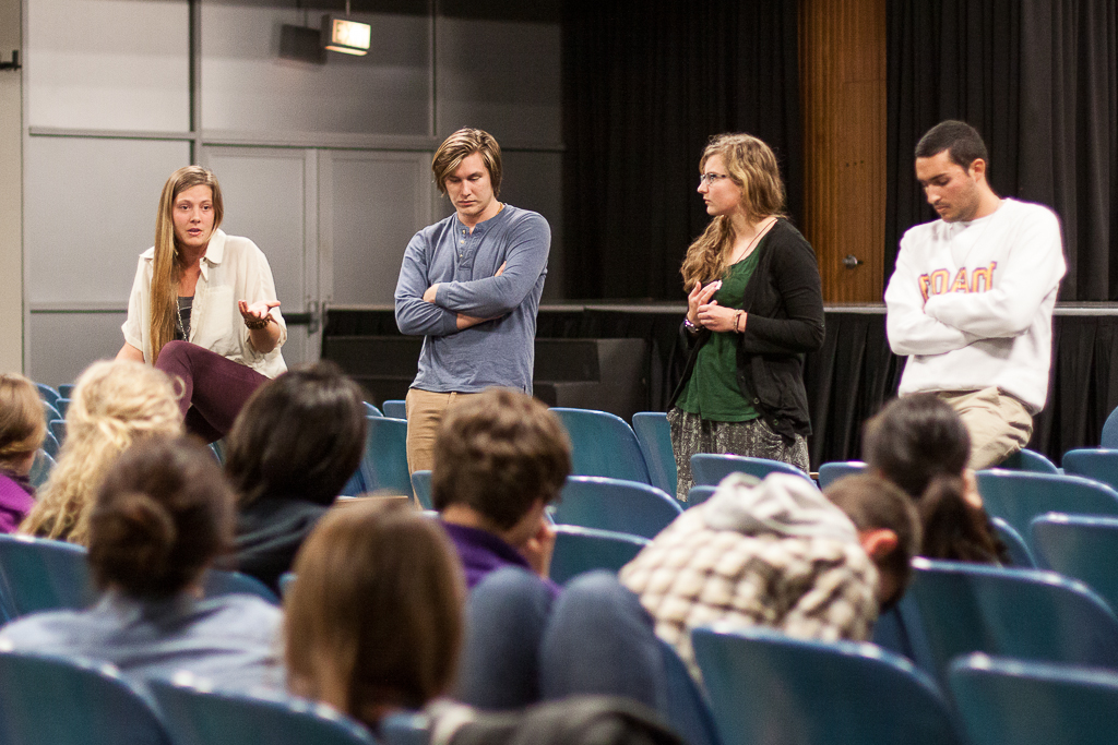(Left to right) Junior Jessica Lindner, sophomore Ben Jacuk, sophomore Anna Grace Hodge and junior Kyle Quiroz are leaders of the Student American Indian Fellowship. On Tuesday, they organized a showing of The Canary Effect, a documentary that looks at the influence of the United States policies on indigenous peoples. | Grant Walter/THE CHIMES