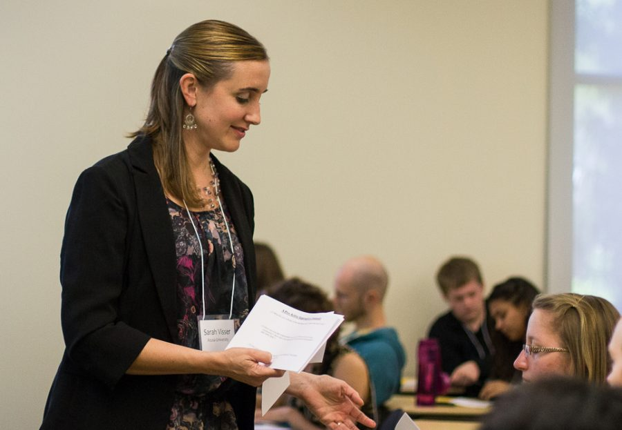 During her Saturday afternoon workshop, Sarah Visser, from Azusa Pacific University, hands out a flyer entitled