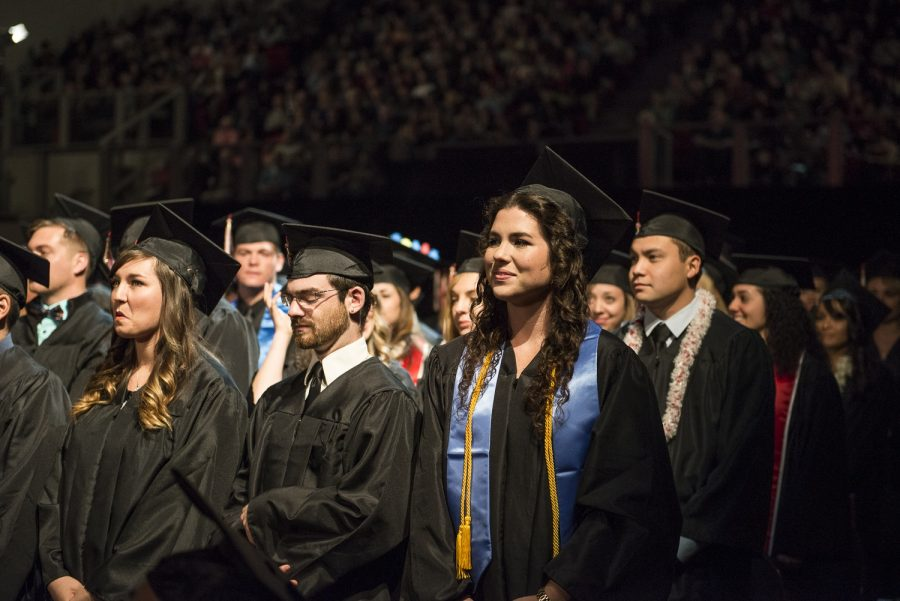 Students prepare to walk up to the stage during fall commencement. In order to improve the retention rate, Biola is working on implementing better academic planning for students. | Job Ang/THE CHIMES