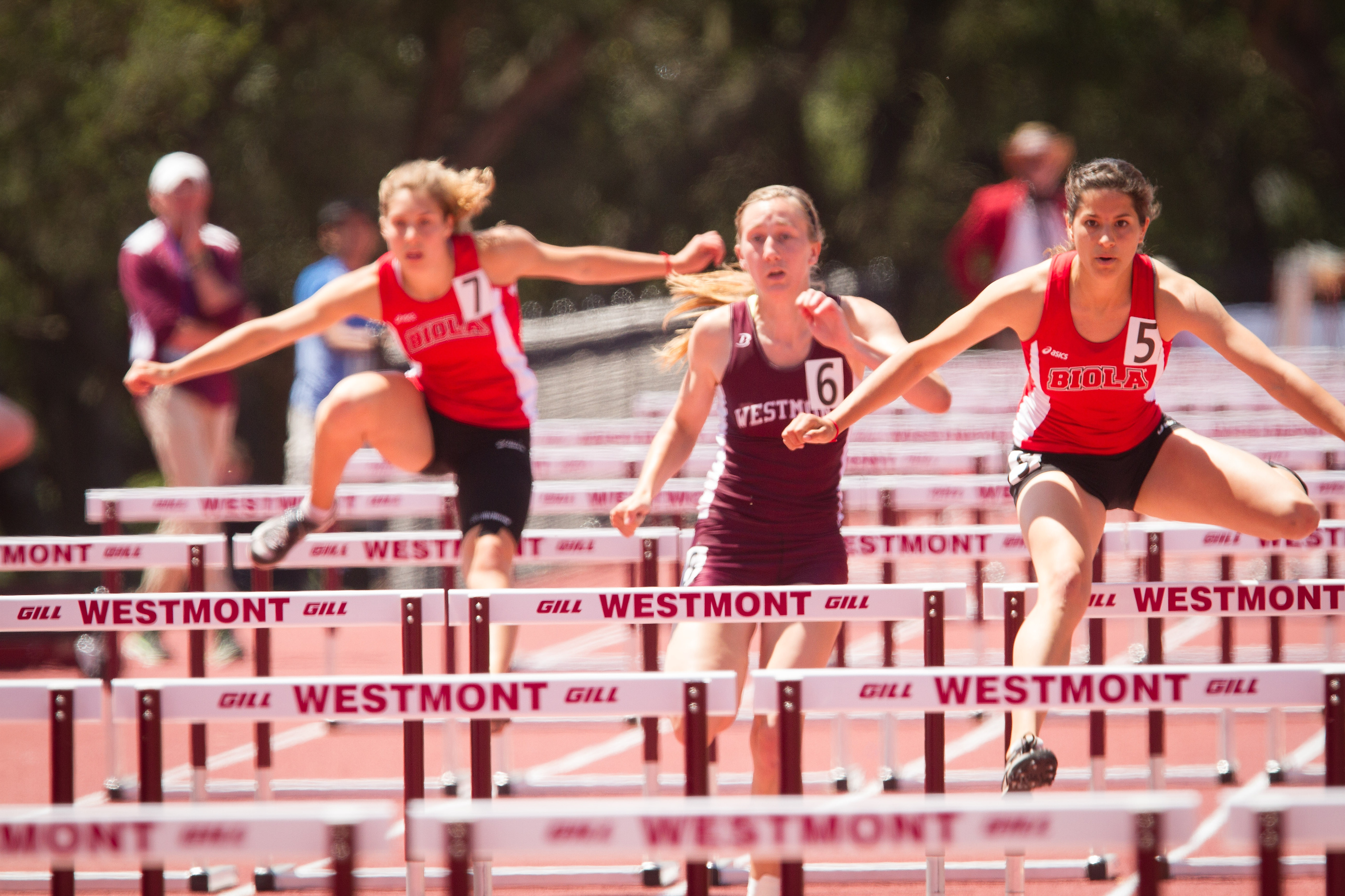 Junior Taylor McCahon (left) finished fifth and senior Lauren Houck (right) finished third in the 100-meter hurdles. Courtesy | Brad Elliott [Westmont College]