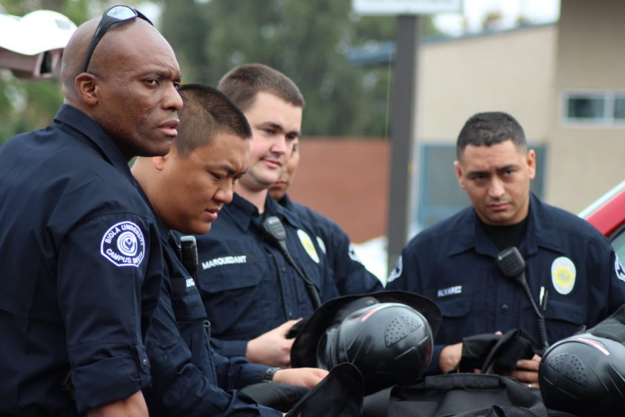 Campus Safety Chief John Ojeisekhoba and his crew of officers put on equipment in preparation for the active shooter drill held on Wednesday, August 14. The drill coordinated with SWAT and the Los Angeles County Sheriff's Department to prepare officers for any situation. The increased security in chapel is part of Ojeisekhoba's plan to make Biola as safe as possible. | Courtesy of Campus Safety