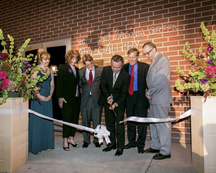 Dr. Barry Corey cuts the ceremonial ribbon during the opening of the Center for Christianity, Culture and the Arts on September 20. In addition to the ribbon cutting, guests enjoyed viewing work from various artists and a jazz concert on Metzger Lawn. | Tomber Su/THE CHIMES
