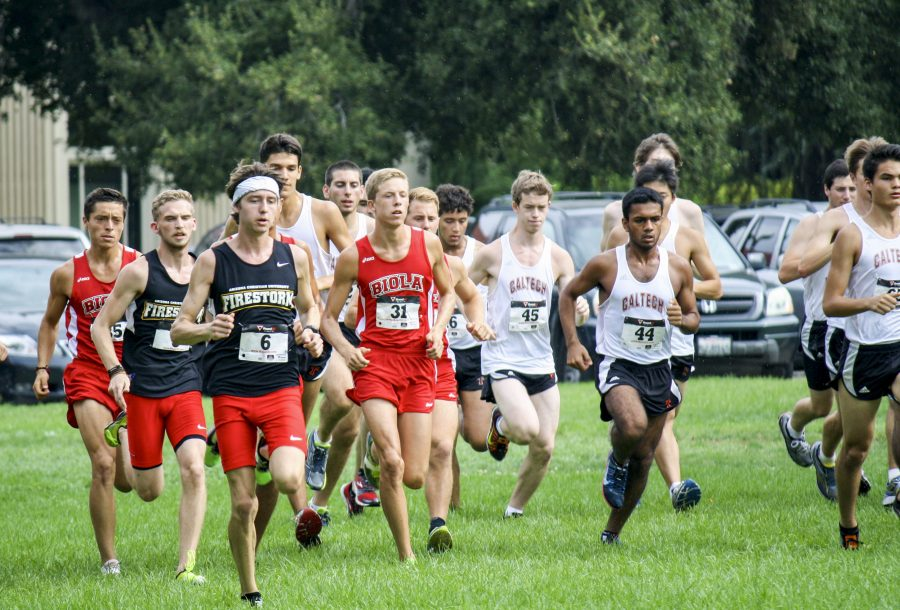Senior Danny Ledesma and freshman Brandon Berz fight to gain a lead among the large crowd during the race at Redlands. | Courtesy of Jessi Kung