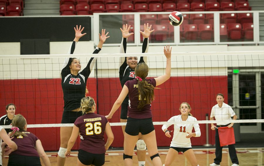 Sophomores Lauren Hoenecke and Joclyn Kirton put up a powerful block against Texas-Brownsville. Unfortunately for women's volleyball, that strength was not enough to overpower the #2 team in the GSAC Conference on October 22. | Tomber Su/THE CHIMES