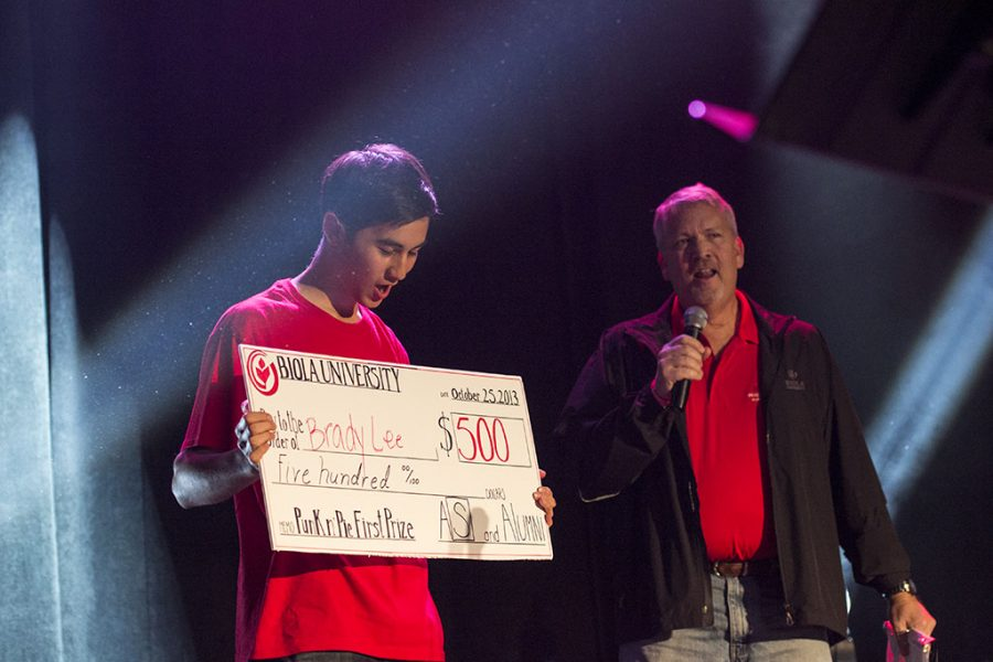 Sophomore Brady Lee marvels at his $500 prize for winning first place with his evangelism magic act. | Ashleigh Fox/THE CHIMES