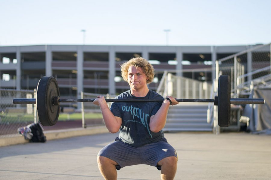 Grossman works his way through a clean during CrossFit Biola. Even with a bulging disc in his back, Grossman fights through the pain, but makes sure to stay in tune to his body, not wanting to hurt himself further. | Ashleigh Fox/THE CHIMES