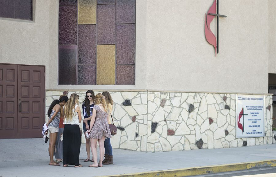 Students gather in front of the United Methodist Church next to Little India in Artesia to pray for churches in India during the Little India Prayer Walk on Friday afternoon. | Ashleigh Fox/THE CHIMES
