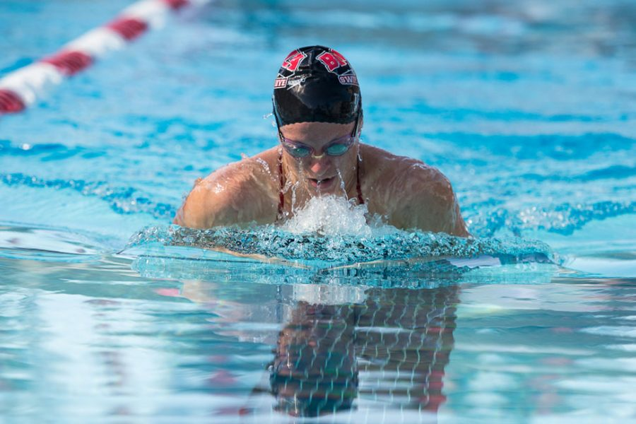 Junior Christine Tixier glides through the water with the breaststroke during the dual meet against Azusa Pacific on November 2. | Ashleigh Fox/THE CHIMES