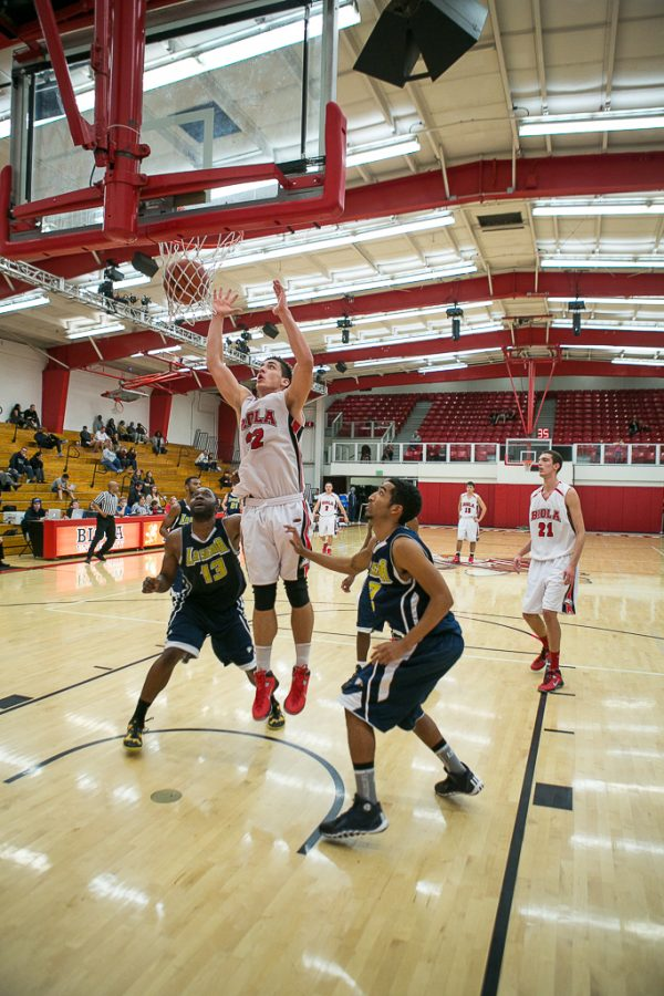 Senior forward Andre Murillo follows through after a made basket during their win against La Sierra University on Dec. 4. Biola overpowered La Sierra 95-86. | Tomber Su/THE CHIMES
