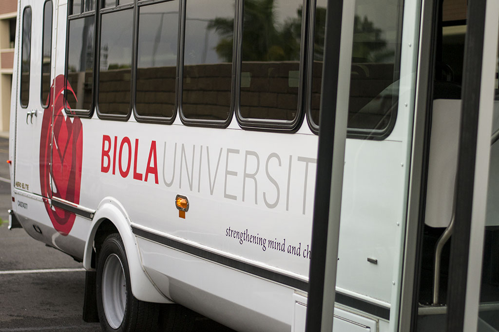The Biola shuttle bus waits for passengers at its pick-up area south of the pool. | Ashleigh Fox/THE CHIMES [file photo]