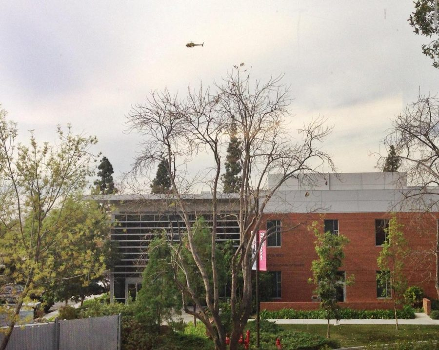 A helicopter circles overhead as the sheriff's department searches for a suspect who ran onto campus. | Courtesy of Amber Amaya