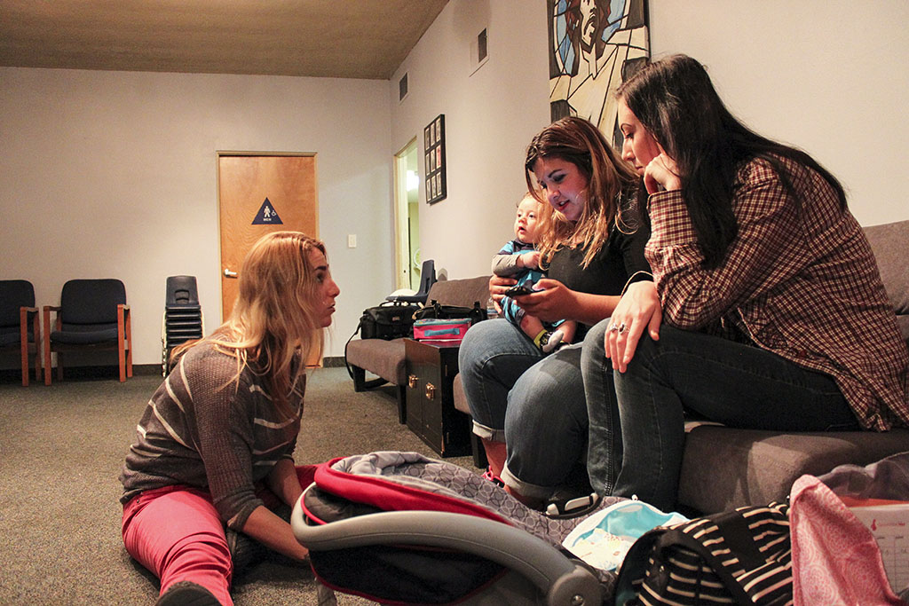 Junior Jessica Dagen, left, discusses the best ways to bond with newborns during Generation Her's