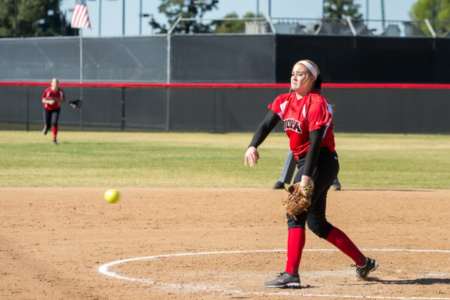 A pitch flies out of the hands of junior right-handed pitcher Reba DePriest during the game against Biola alumni last Saturday. | Ashleigh Fox/THE CHIMES