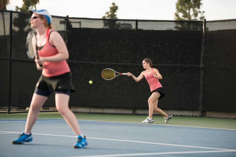Junior Kathryn Ashford returns the ball in her doubles match with partner Susan Carmichael to pick up a win against University of Southwest last season. | Ashleigh Fox/THE CHIMES [file photo]