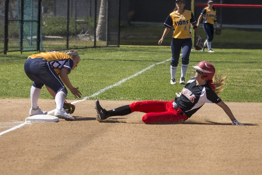 Senior catcher Celina Thornton slides in an effort to get on base to set up a chance to score against the Vanguard Lions on Saturday afternoon. Although the Eagles defeated the Lions in the first game 3-2, they were not able to produce similar results in the second game and fell 2-0. | Aaron Fooks/THE CHIMES