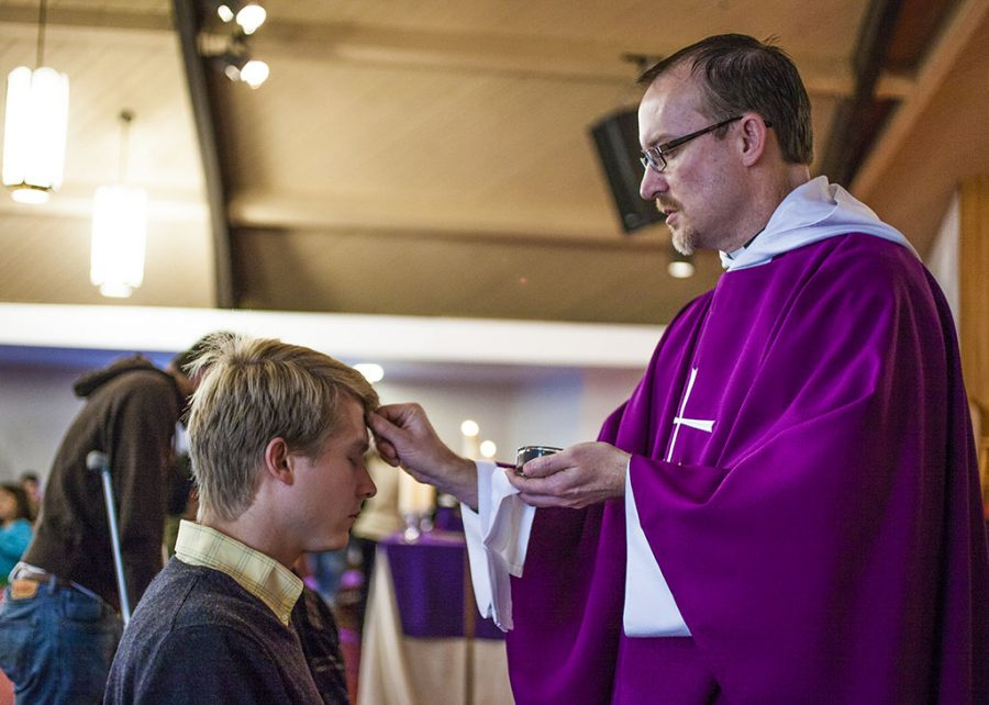 Alumnus Jonathan Rowley (05), an auxiliary services assistant manager at Biola, receives ashes during the 6:30 a.m. service at the Anglican Church of the Epiphany, held at Redeemer Church on Imperial Highway. Ash Wednesday begins the season of Lent. | Melanie Kim/THE CHIMES