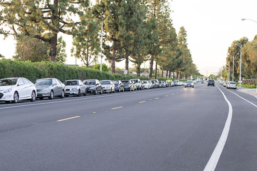 Parking just outside of Biola, on Biola Avenue, will be prohibited by Biola. Students driving to school will be required to purchase a parking permit to help pay off bonds taken out to build the parking structures. | Ashleigh Fox/THE CHIMES
