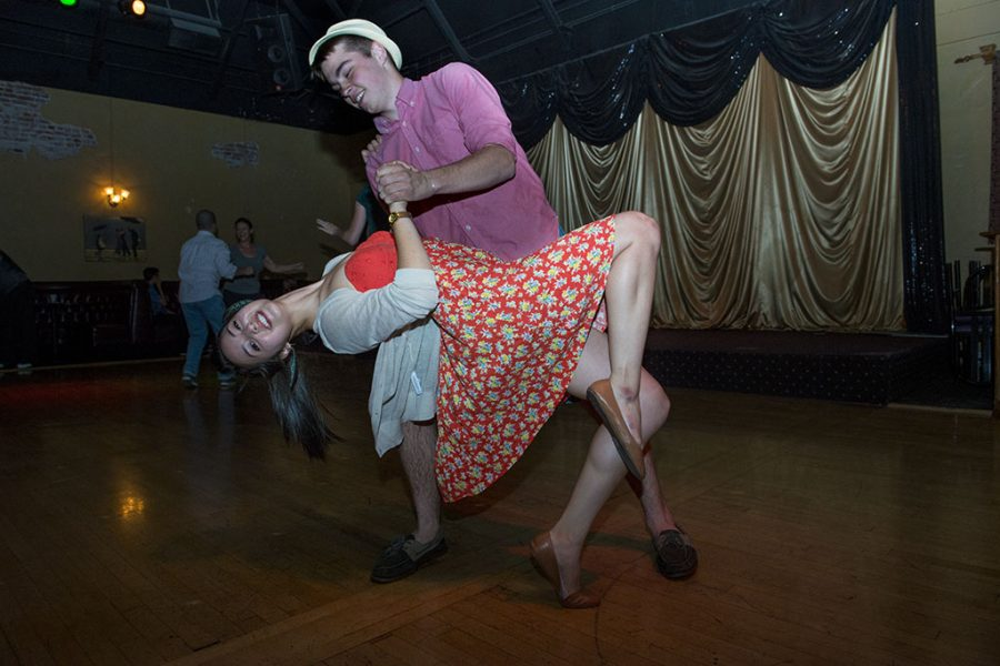 Freshmen Emily Justiniano and Andrew Schundler swing dance at Memories in uptown Fullerton, a favorite Biola pastime. | Aaron Fooks/THE CHIMES