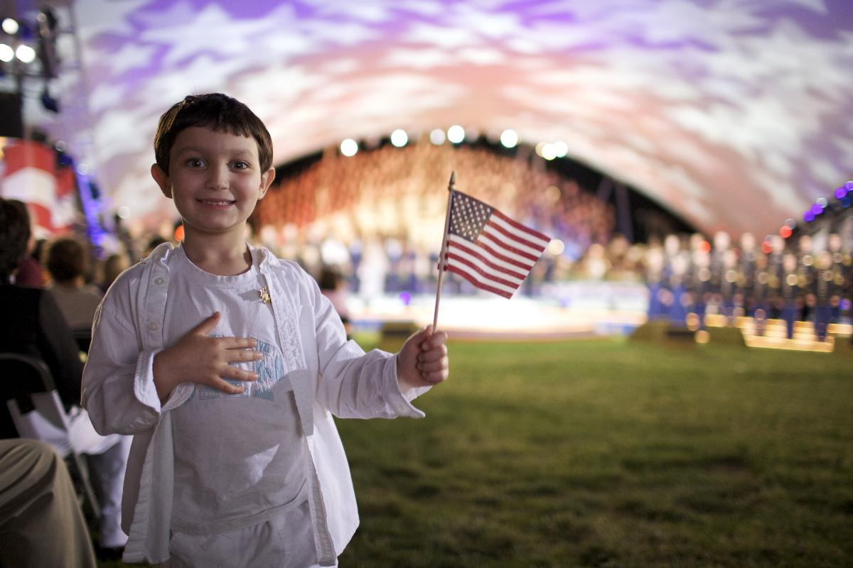 A boy holds an American flag during the 2009 National Memorial Day Concert in Washington, D.C. The Chimes staff begins a conversation about the cultural ignorance of Americans.