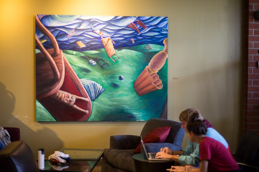 In an attempt to fill the campus with more artwork, several art pieces hang on the walls of the Student Union Building, including this piece next to a section of couches. | Aaron Fooks/THE CHIMES
