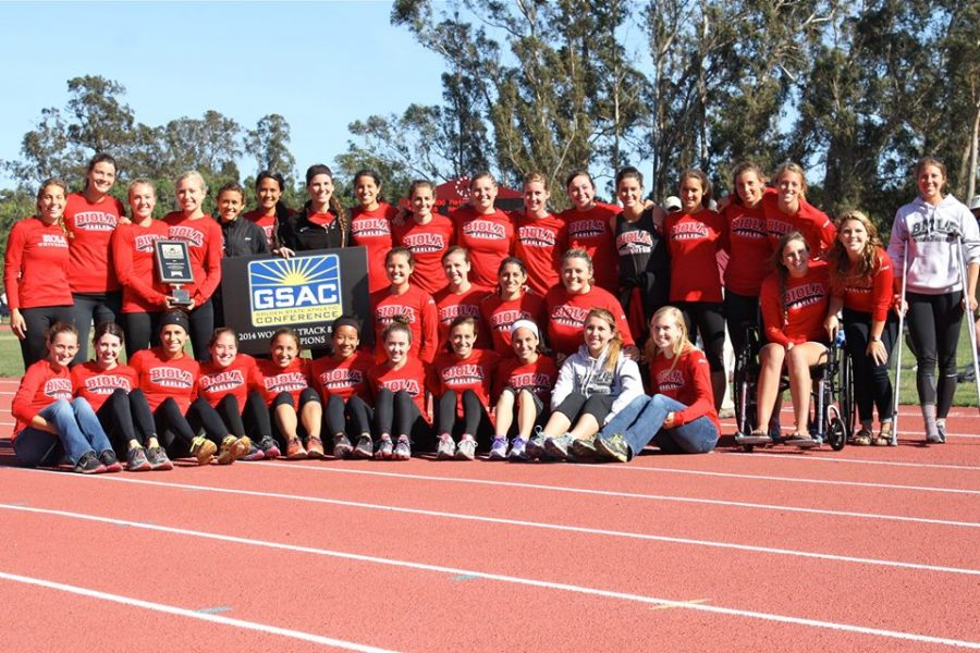 The womens track and field team members pose with their first place plaque after the completion of the GSAC championships last weekend. This is the second year in a row that the women have earned the top spot at GSAC. | Courtesy of Jonathan Zimmerman