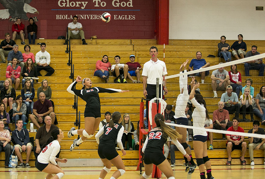 Junior outside hitter Joclyn Kirton goes up for a kill during the game versus San Diego Christian on October 10. Kirton led the Eagles in kills for the entire match with 14 total. | Tomber Su/THE CHIMES  (October 2013)